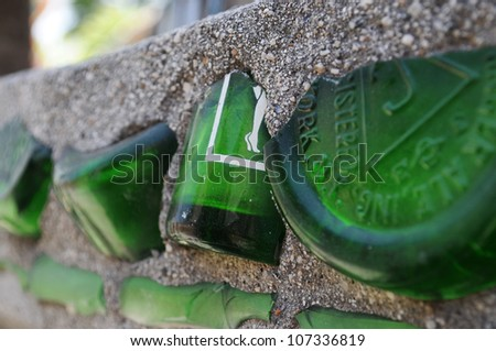 LOS ANGELES, CA - MAY 19: Detail of broken soft-drink bottles embedded in concrete at Watts Towers in Los Angeles on May 19, 2012. Simon Rodia used everyday objects to decorate the towers he built. - stock photo