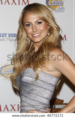 LOS ANGELES, CA - MAY 19: Stacy Keibler arrives at the 11th annual Maxim Hot 100 Party at Paramount Studios on May 19, 2010 in Los Angeles, California