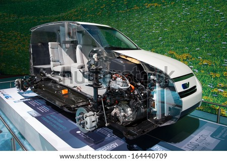 LOS ANGELES, CA - NOVEMBER 20: A cutaway of the Toyota RAV4 EV electric SUV on exhibit at the Los Angeles Auto Show in Los Angeles, CA on November 20, 2013 - stock photo