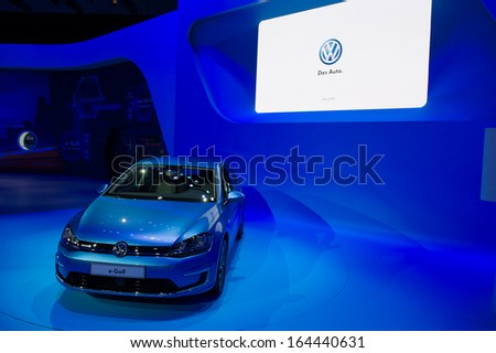 LOS ANGELES, CA - NOVEMBER 20: A Volkswagen e-Golf on exhibit at the Los Angeles Auto Show in Los Angeles, CA on November 20, 2013 - stock photo