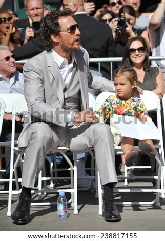 LOS ANGELES, CA - NOVEMBER 17, 2014: Actor Matthew McConaughey & daughter on Hollywood Boulevard where he was honored with the 2,534th star on the Hollywood Walk of Fame.  - stock photo
