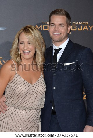 "LOS ANGELES, CA - NOVEMBER 16, 2015: Actor Wes Chatham wife sports broadcaster Jenn Brown at the Los Angeles premiere of ""The Hunger Games: Mockingjay - Part 2"" at the Microsoft Theatre, LA Live."