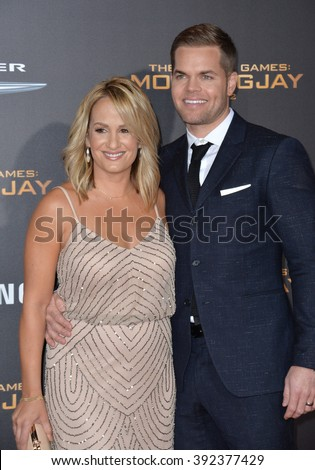 "LOS ANGELES, CA - NOVEMBER 16, 2015: Actor Wes Chatham wife sports broadcaster Jenn Brown at the premiere of ""The Hunger Games: Mockingjay - Part 2"""