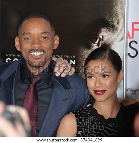 """LOS ANGELES, CA - NOVEMBER 10, 2015: Actors Will Smith & Gugu Mbatha-Raw at the premiere of their movie """"Concussion"""", part of the AFI FEST 2015, at the TCL Chinese Theatre, Hollywood. - stock photo"""
