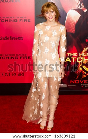 LOS ANGELES, CA - NOVEMBER 18: Actress Bella Thorne arrives at the premiere of The Hunger Games: Catching Fire at the Nokia Theater in Los Angeles, CA on November 18, 2013 - stock photo