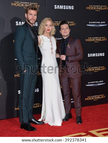 "LOS ANGELES, CA - NOVEMBER 16, 2015: Actress Jennifer Lawrence & actors Liam Hemsworth & Josh Hutcherson (right) at the premiere of ""The Hunger Games: Mockingjay - Part 2"""