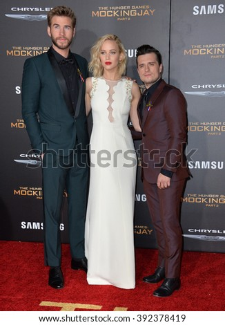 "LOS ANGELES, CA - NOVEMBER 16, 2015: Actress Jennifer Lawrence & actors Liam Hemsworth & Josh Hutcherson (right) at the premiere of ""The Hunger Games: Mockingjay - Part 2"" - stock photo"