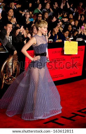 LOS ANGELES, CA - NOVEMBER 18: Actress Jennifer Lawrence arrives at the premiere of The Hunger Games: Catching Fire at the Nokia Theater in Los Angeles, CA on November 18, 2013 - stock photo