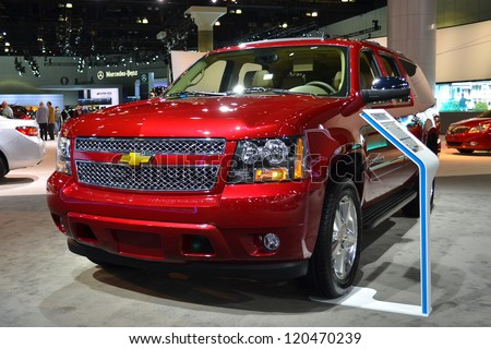 LOS ANGELES, CA. - NOVEMBER 30:  Chevrolet Suburban 2WD on display  at the 2012 Los Angeles Auto Show on November 30, 2012 at the L.A. Convention Center in Los Angeles. - stock photo
