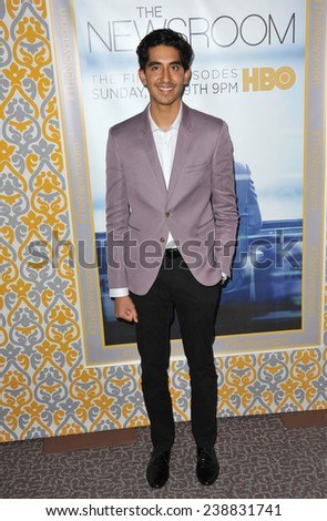 "LOS ANGELES, CA - NOVEMBER 4, 2014: Dev Patel at the season three premiere of his HBO series ""The Newsroom"" at the Directors Guild of America Theatre, West Hollywood.  - stock photo"