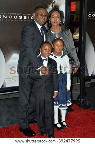 """LOS ANGELES, CA - NOVEMBER 10, 2015: Dr. Bennet Omalu & wife Prema Mutiso & children Ashly Omalu & Mark Omalu at the premiere of the movie based on his work """"Concussion"""" at the TCL Chinese Theatre - stock photo"""