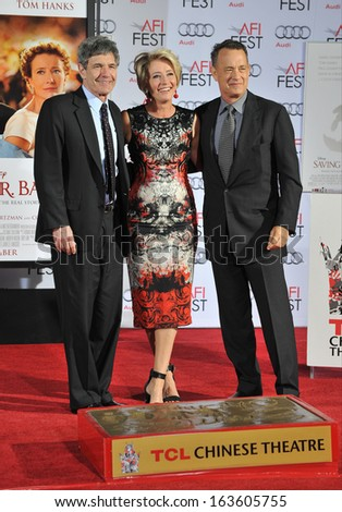LOS ANGELES, CA - NOVEMBER 7, 2013: Emma Thompson & Tom Hanks & Alan Horn (left), chairman of Walt Disney Studios, at the TCL Chinese Theatre where she had her hand & footprints set in cement.  - stock photo