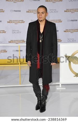 """LOS ANGELES, CA - NOVEMBER 17, 2014: Evan Ross (son of Diana Ross) at the Los Angeles premiere of his movie """"The Hunger Games: Mockingjay Part One"""" at the Nokia Theatre LA Live.  - stock photo"""