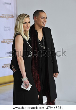"""LOS ANGELES, CA - NOVEMBER 17, 2014: Evan Ross (son of Diana Ross) & wife Ashlee Simpson at the Los Angeles premiere of his movie """"The Hunger Games: Mockingjay Part One"""" at the Nokia Theatre LA Live. - stock photo"""