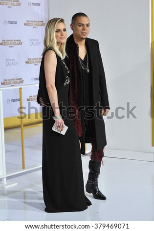 "LOS ANGELES, CA - NOVEMBER 17, 2014: Evan Ross (son of Diana Ross) & wife Ashlee Simpson at the Los Angeles premiere of his movie ""The Hunger Games: Mockingjay Part One"" at the Nokia Theatre LA Live. - stock photo"