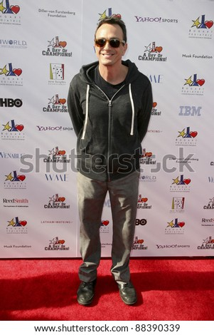 LOS ANGELES, CA - NOVEMBER 06: Hank Azaria arrives at A Day Of Champions Benefiting the Bogart Pediatric Cancer Research Program at Sports Museum of Los Angeles on November 6, 2011. - stock photo