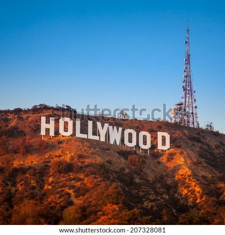 LOS ANGELES, CA - NOVEMBER 22: Hollywood sigh white letters at sunset  on November 22, 2013 in Los Angeles, California. - stock photo