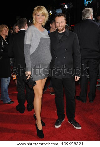 "LOS ANGELES, CA - NOVEMBER 9, 2009: Jenna Elfman & husband Bodhi Elfman at the world premiere of Walt Disney's ""Old Dogs"" at the El Capitan Theatre, Hollywood. - stock photo"