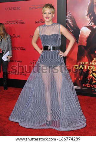 "LOS ANGELES, CA - NOVEMBER 18, 2013: Jennifer Lawrence at the US premiere of her movie ""The Hunger Games: Catching Fire"" at the Nokia Theatre LA Live.  - stock photo"