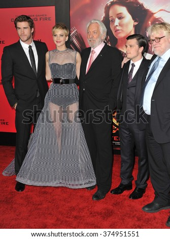 "LOS ANGELES, CA - NOVEMBER 18, 2013: Jennifer Lawrence, Liam Hemsworth (left), Donald Sutherland, Josh Hutcherson & Philip Seymour Hoffman at the premiere of ""The Hunger Games: Catching Fire"". - stock photo"
