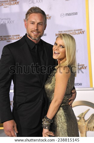 "LOS ANGELES, CA - NOVEMBER 17, 2014: Jessica Simpson & husband Eric Johnson at the Los Angeles premiere of ""The Hunger Games: Mockingjay Part One"" at the Nokia Theatre LA Live.  - stock photo"