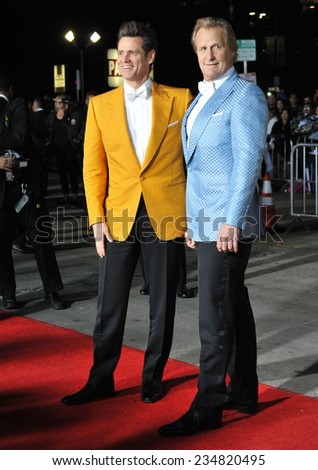 """LOS ANGELES, CA - NOVEMBER 3, 2014: Jim Carrey & Jeff Daniels (right) at the premiere of their movie """"Dumb and Dumber To"""" at the Regency Village Theatre, Westwood.  - stock photo"""