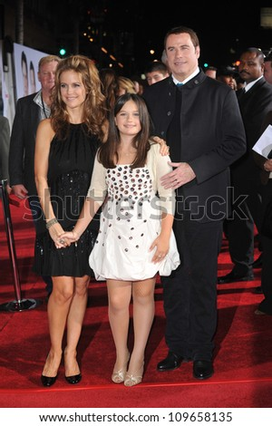 "LOS ANGELES, CA - NOVEMBER 9, 2009: John Travolta & wife Kelly Preston & daughter Ella Beu Travolta at the world premiere of their movie Walt Disney's ""Old Dogs"" at the El Capitan Theatre, Hollywood."