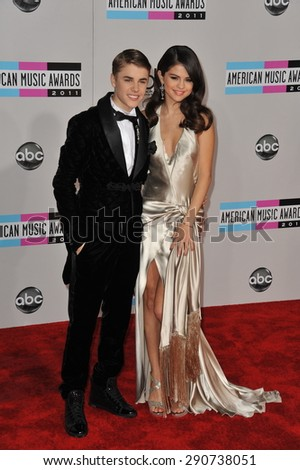 LOS ANGELES, CA - NOVEMBER 20, 2011: Justin Bieber & Selena Gomez arriving at the 2011 American Music Awards at the Nokia Theatre, L.A. Live in downtown Los Angeles. - stock photo