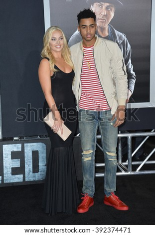 "LOS ANGELES, CA - NOVEMBER 19, 2015: LA Lakers basketball star D'Angelo Russell & guest at the premiere of ""Creed"""