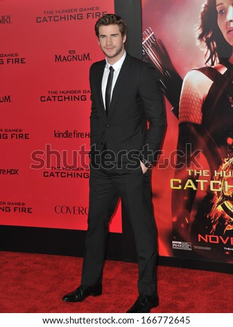 """LOS ANGELES, CA - NOVEMBER 18, 2013: Liam Hemsworth at the US premiere of his movie """"The Hunger Games: Catching Fire"""" at the Nokia Theatre LA Live.  - stock photo"""