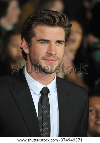 "LOS ANGELES, CA - NOVEMBER 18, 2013: Liam Hemsworth at the US premiere of his movie ""The Hunger Games: Catching Fire"" at the Nokia Theatre LA Live. Picture: Paul Smith / Featureflash - stock photo"