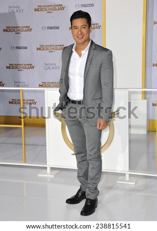 """LOS ANGELES, CA - NOVEMBER 17, 2014: Mario Lopez at the Los Angeles premiere of """"The Hunger Games: Mockingjay Part One"""" at the Nokia Theatre LA Live.  - stock photo"""