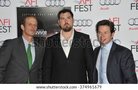"""LOS ANGELES, CA - NOVEMBER 12, 2013: Mark Wahlberg (right), retired Petty Officer 1st Class Marcus Luttrell & writer/director Peter Berg at the premiere of  """"Lone Survivor"""" at the Chinese Theatre - stock photo"""