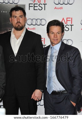 """LOS ANGELES, CA - NOVEMBER 12, 2013: Mark Wahlberg (right) with rtd Petty Officer 1st Class Marcus Luttrell at the premiere of """"Lone Survivor"""" at the TCL Chinese Theatre, Hollywood.  - stock photo"""