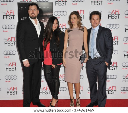 """LOS ANGELES, CA - NOVEMBER 12, 2013: Mark Wahlberg & wife Rhea Durham (right) with retired Petty Officer 1st Class Marcus Luttrell & wife at the premiere of """"Lone Survivor"""" at the Chinese Theatre - stock photo"""