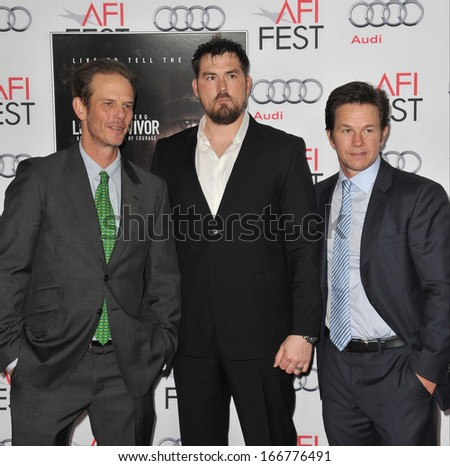 """LOS ANGELES, CA - NOVEMBER 12, 2013: Mark Wahlberg with rtd Petty Officer Marcus Luttrell & writer/director Peter Berg (left) at the world premiere of """"Lone Survivor"""" at the TCL Chinese Theatre.  - stock photo"""