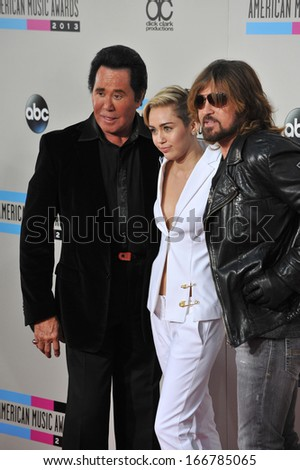 LOS ANGELES, CA - NOVEMBER 24, 2013: Miley Cyrus & father Billy Ray Cyrus with Wayne Newton (left) at the 2013 American Music Awards at the Nokia Theatre, LA Live.  - stock photo