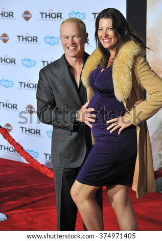 """LOS ANGELES, CA - NOVEMBER 4, 2013: Neal McDonough & wife Ruve McDonough at the US premiere of """"Thor: The Dark World"""" at the El Capitan Theatre, Hollywood. Picture: Paul Smith / Featureflash - stock photo"""