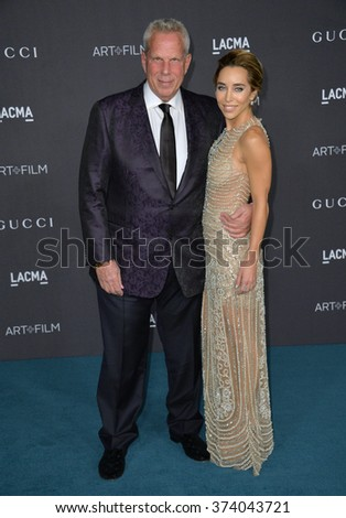 LOS ANGELES, CA - NOVEMBER 7, 2015: Producer Steve Tisch & guest at the 2015 LACMA Art+Film Gala at the Los Angeles County Museum of Art.