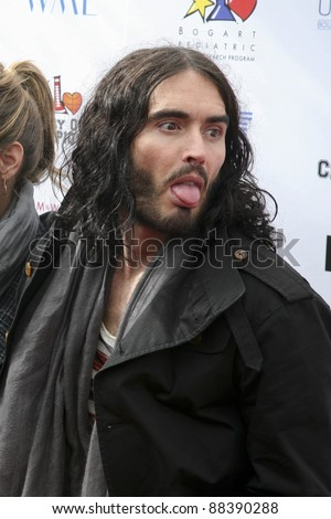 LOS ANGELES, CA - NOVEMBER 06: Russell Brand arrives at A Day Of Champions Benefiting the Bogart Pediatric Cancer Research Program at Sports Museum of Los Angeles on November 6, 2011. - stock photo