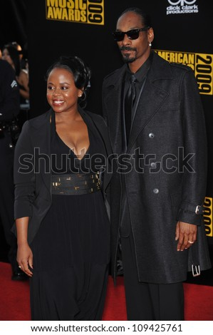 LOS ANGELES, CA - NOVEMBER 22, 2009: Snoop Dogg & wife Shante Taylor at the 2009 American Music Awards at the Nokia Theatre L.A. Live. - stock photo