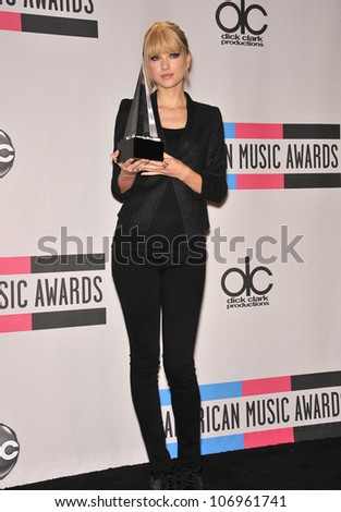 LOS ANGELES, CA - NOVEMBER 21, 2010: Taylor Swift at the 2010 American Music Awards at the Nokia Theatre L.A. Live. - stock photo