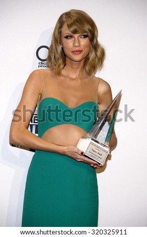 LOS ANGELES, CA - NOVEMBER 23, 2014: Taylor Swift at the 2014 American Music Awards held at the Nokia Theatre L.A. Live in Los Angeles on November 23, 2014. - stock photo