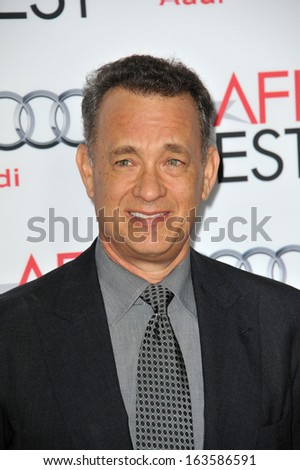 """LOS ANGELES, CA - NOVEMBER 7, 2013: Tom Hanks at the premiere of his movie """"Saving Mr Banks"""", the opening movie of the AFI FEST 2013, at the TCL Chinese Theatre, Hollywood.  - stock photo"""