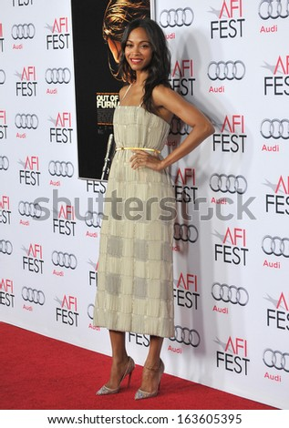 "LOS ANGELES, CA - NOVEMBER 9, 2013: Zoe Saldana at the Los Angeles premiere of her movie ""Out of the Furnace"", part of the AFI Fest 2013, at the TCL Chinese Theatre, Hollywood."