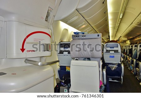LOS ANGELES, CA -8 OCT 2017- Coach seats inside the Economy Plus cabin of a Boeing 777 airplane from United Airlines (UA). Seats in the emergency exit row offer more legroom.