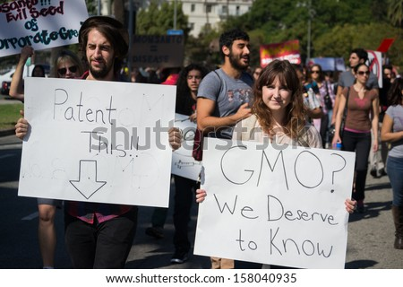 LOS ANGELES CA- OCT 12: Protesters rallied in the streets against the Monsanto corporation. The company is accused of genetically modifying foods unsafely. October 12, 2013 in Los Angeles, CA.