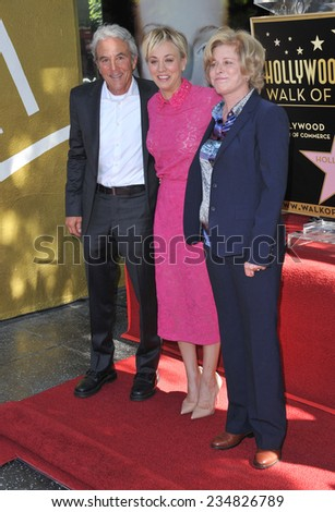 LOS ANGELES, CA - OCTOBER 29, 2014: Actress Kaley Cuoco with her parents on Hollywood Boulevard where she was honored with the 2,532nd star on the Hollywood Walk of Fame.