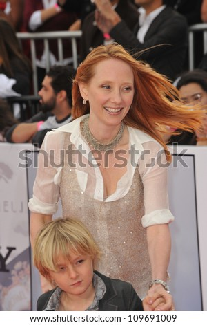 "LOS ANGELES, CA - OCTOBER 27, 2009: Anne Heche & son at the premiere of Michael Jackson's ""This Is It"" at the Nokia Theatre, L.A. Live."