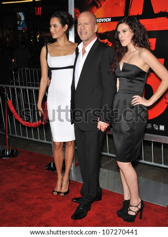 """LOS ANGELES, CA - OCTOBER 11, 2010: Bruce Willis & wife Emma Heming (left) & daughter Rumer Willis at the premiere of his new movie """"Red"""" at Grauman's Chinese Theatre, Hollywood. - stock photo"""